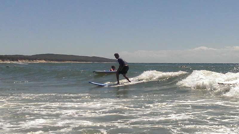Learn to surf on Queensland's pristine northern most surf beach!