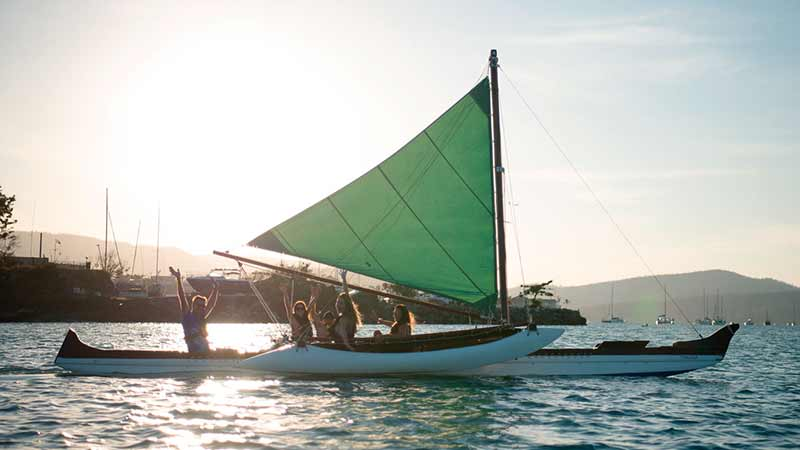 Join us for an unforgettable unique sunset over Airlie Beach in the only Hawaiian sailing outrigger canoe in Australia