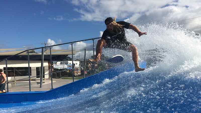 Put your board riding skills to test on the Tobruk Flow Rider in Cairns and experience endless surfing fun!